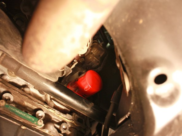 Image 1/1: Once the rubber gasket contacts the engine block, use the channel locks to turn the filter one full turn CW.