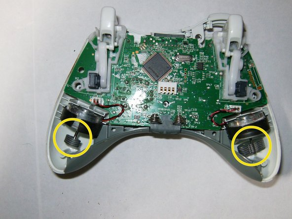 Image 2/3: Remove the connector from the left motor (controller is positioned upside down, left controller will be shown right etc.)