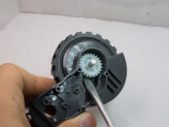 Remove the main gear using a flathead screwdriver. This is the most difficult step - unfortunately the part was definitely not designed to be serviceable.