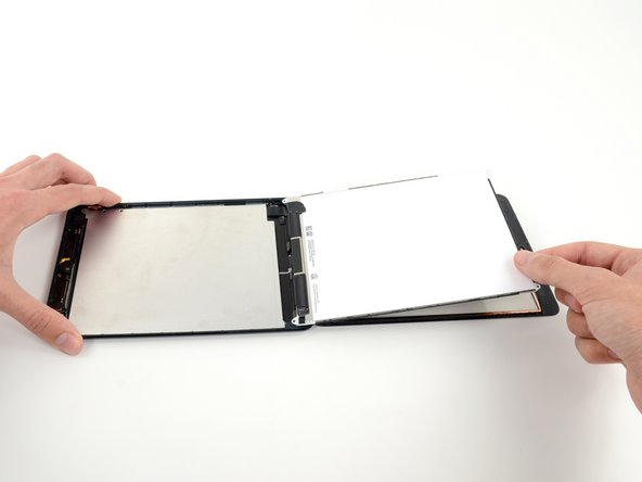 Do not attempt to remove the LCD from the iPad, as it is still connected by its data cable.