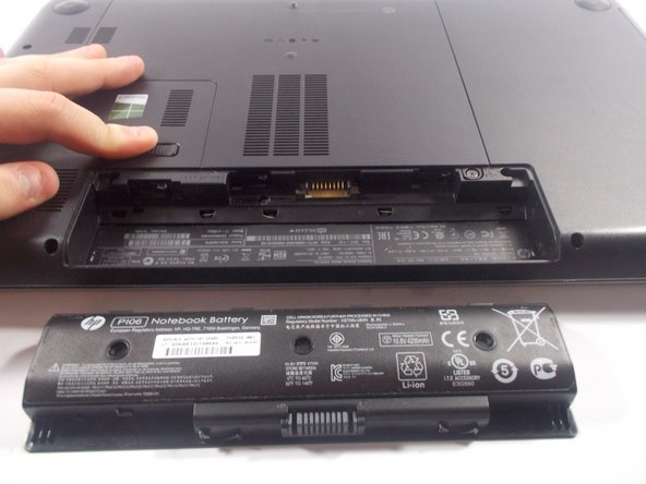 Press and hold the release switch, and then slide the battery out. Insert the new battery into the slot and you're done!