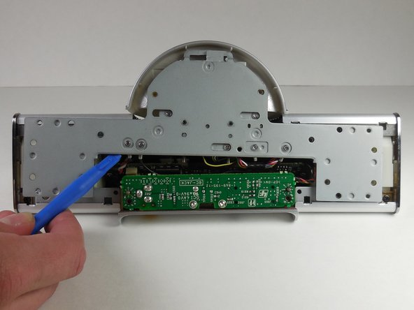 Remove six 5 mm Phillips #0 screws from the metal backing.