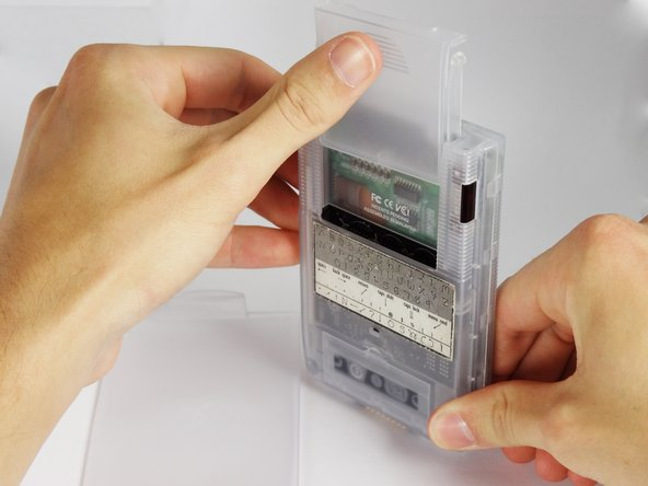Slide the memory cartridge cover up and off the device.