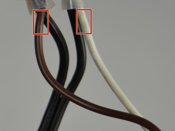 Strip the plastic coating off the edge of the brown and white wires using a wire stripper.