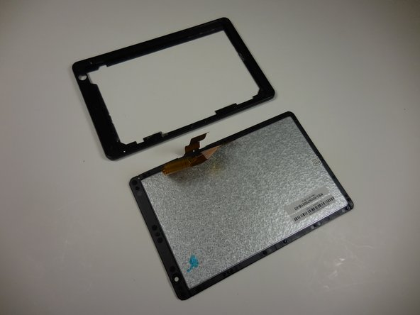 Gently separate the screen from the plastic border/screen holder by pulling it off with your hands.