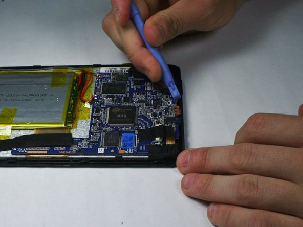 Once the screws are out, use a plastic opening tool to gently apply pressure on the edge of the circuit board against the edge of the tablet. This will pop each of the component heads out of their sockets on the edge of the tablet, leaving the circuit board loose inside.
