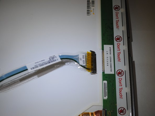 Remove the cable by squeezing each side of the connector and gently pulling straight out.