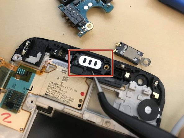 Also remove the earpiece casing from the old screen by popping it out with a pair of tweezers.