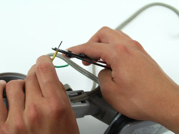 Strip the green and yellow wire about two centimeters from where it was just cut.