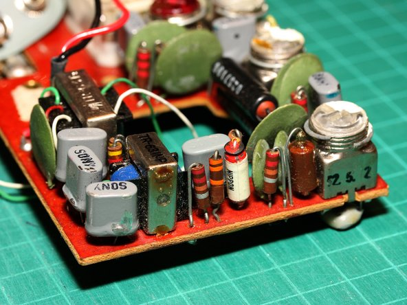 """Image 3/3: Six of the gray components with an oval cross-section (marked or stamped with """"Sony"""") are transistors."""