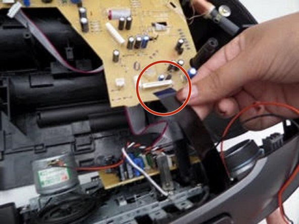 Image 2/3: Also disconnect the pink and white wires connecting the cassette unit to the device.