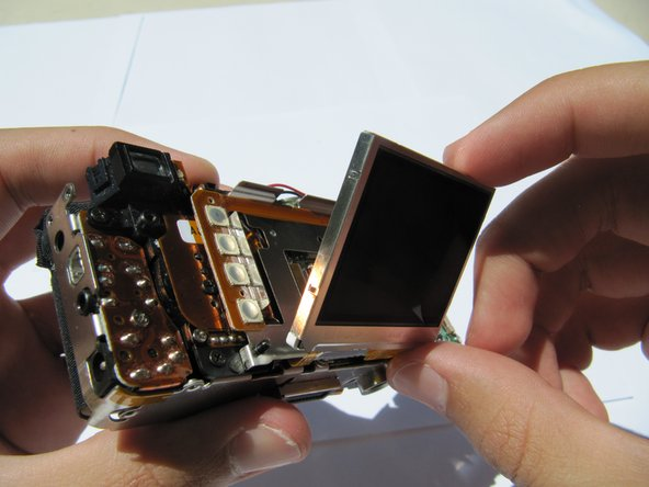 Carefully flip the LCD panel to expose the central circuit board.