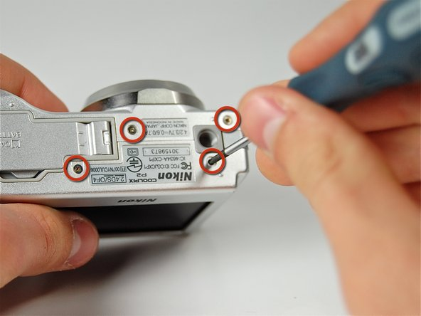 Image 1/1: Remove all four screws from the bottom of the camera with a Phillips 00 screwdriver.