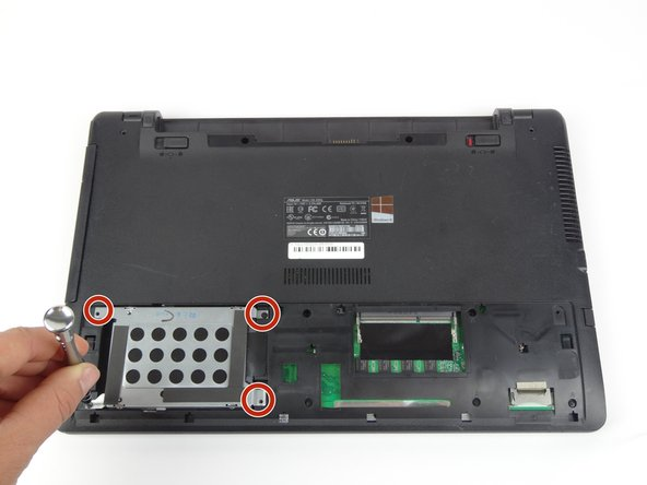 Remove the four 5.5mm screws located on the hard drive case using a Tri-wing Y1 screwdriver.