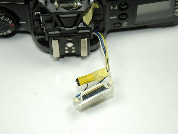 Pull off yellow capacitor from flash wiring.
