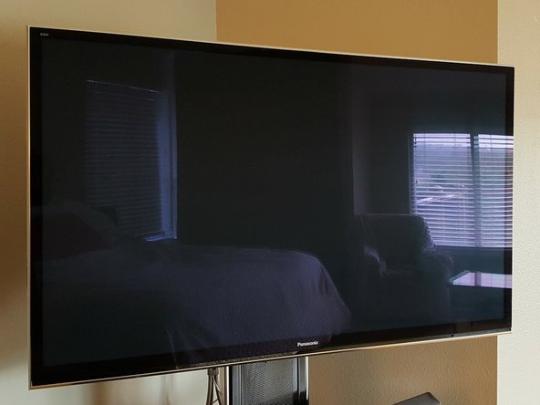 Remove the TV from the stand and place glass down on a flat, soft, and clean surface where you will have easy access to all four sides of it.