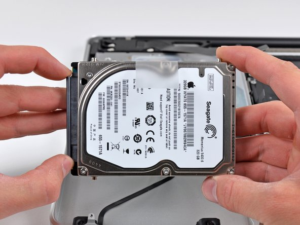 Image 1/2: Pull the hard drive connector out of its socket on the hard drive.