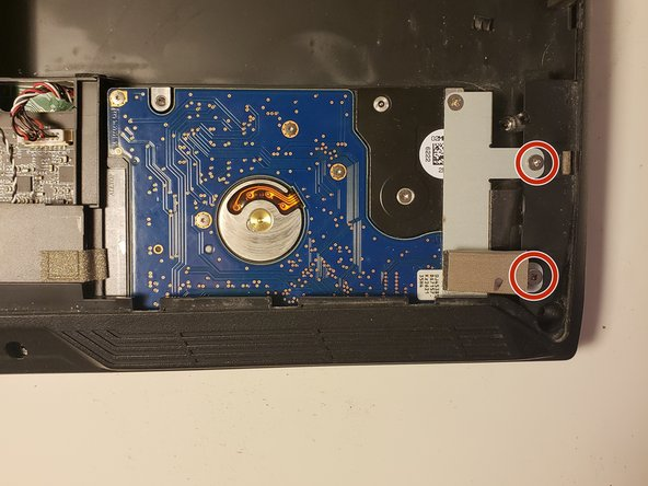 Remove the two screws securing the hard drive to the laptop.