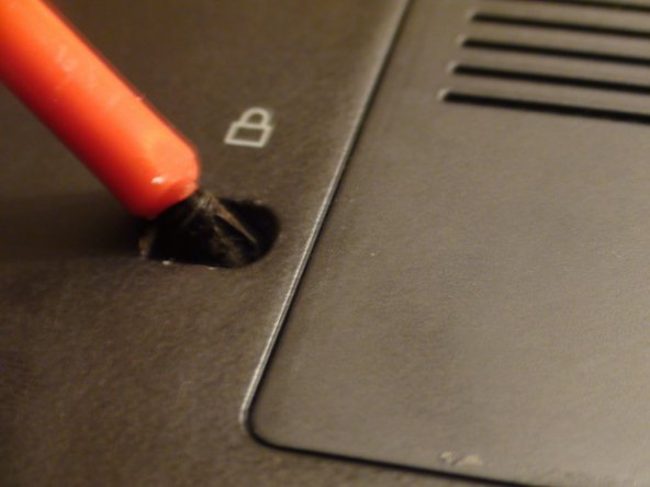 Remove this screw with a Phillips #1 screwdriver.