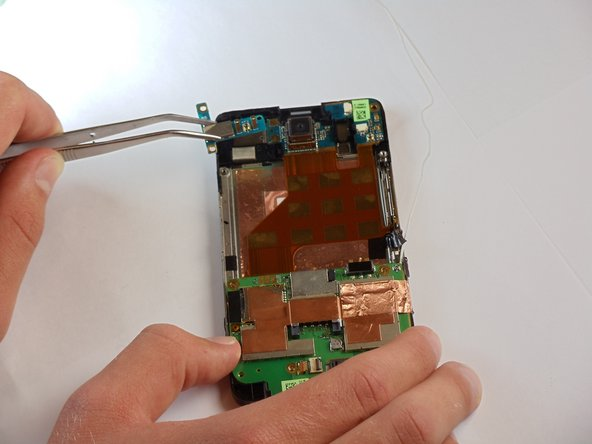 With the cable removed, pop the GPS board out of the phone using tweezers.