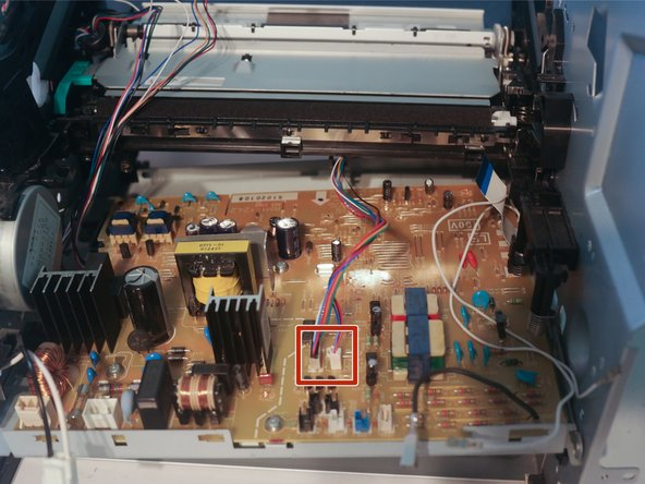 Bend the chassis to allow the control board to come loose, and disconnect the 2 cables to the paper feed assembly to remove the control board.