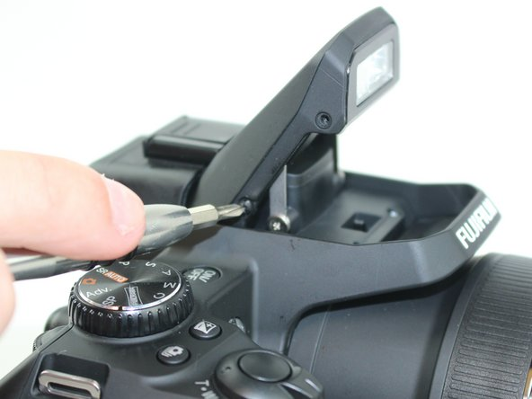 Remove the 4 screws from the flash casing.