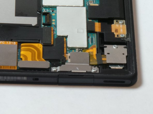 Located in the bottom left of the device you will remove the two screws holding the metal plate on the USB port.