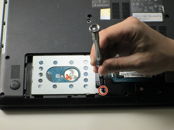 Remove the other 8mm Phillips #0 screw holding the hard drive to the rest of the laptop.