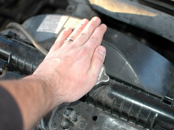 Before proceeding very carefully check that the coolant temperature is low enough to safely check the coolant level.