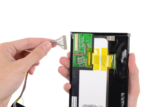 Image 3/3: Disconnecting one cable from the display assembly allows us to completely remove it for further examination.