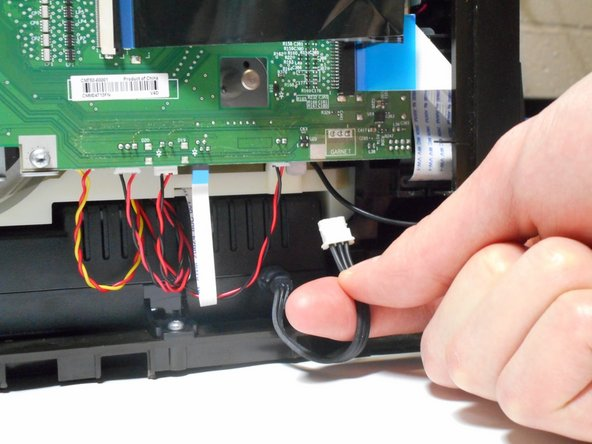 Unplug the black wire with the white cap connecting the power supply to the motherboard.