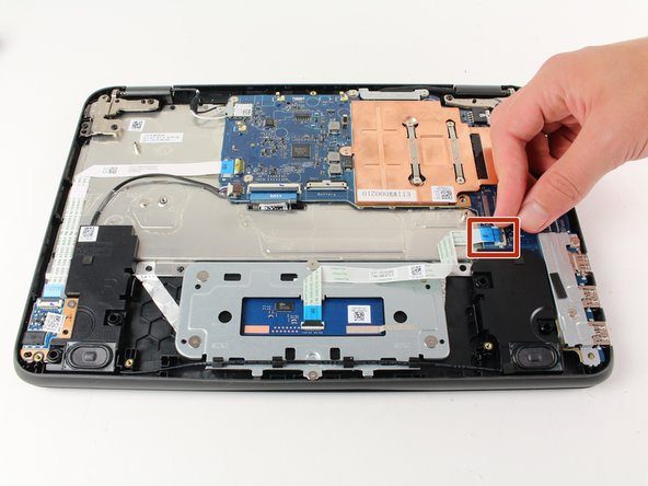 Lift the black clasp and gently pull on blue ribbon until it completely disconnects from the motherboard.