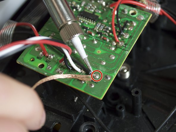 Desolder. Use a solder kit to desolder the wires.  Make sure to desolder the wires as close to the motherboard as possible. There are ten wires total to desolder.