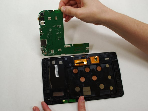 Image 2/2: The motherboard may resist as you try to lift it --this is normal.