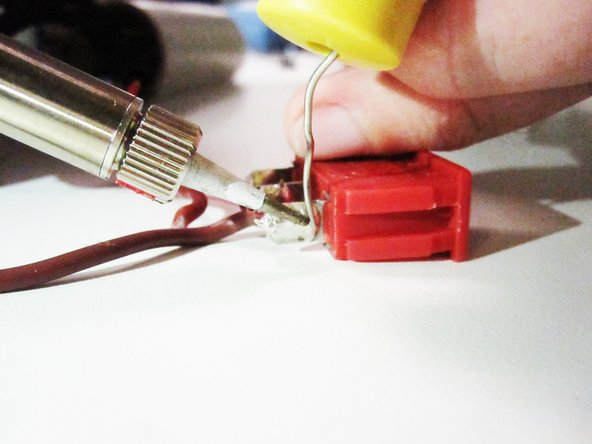 Use soldering iron to remove the electrical wiring from the power switch. To replace the power switch, solder the new switch onto the wires.