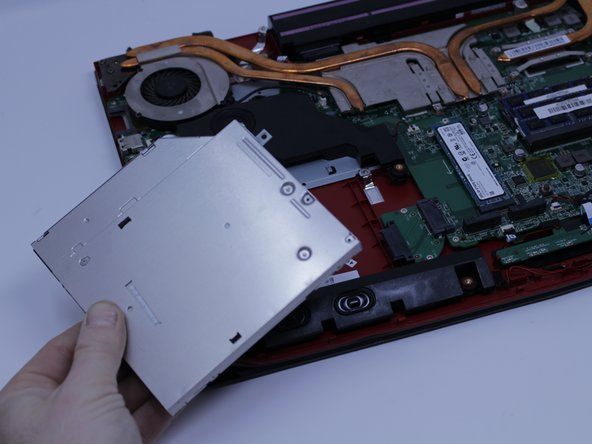 The red marker shows the location for where the retaining screw comes through the back panel to hold the Optical Drive.