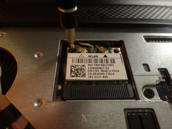 Image 2/3: Replace with a new wireless card, reattaching the power cables.