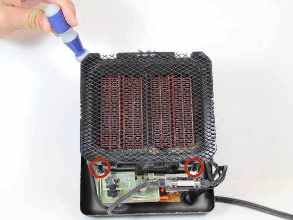 Remove the three 10 mm screws that attach the fan to the heating coil assembly using the #2 Phillip Screwdriver.