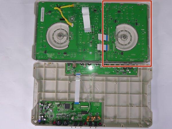 Locate the top right PCB circuit board.