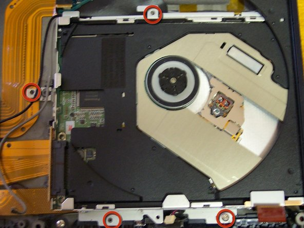 Remove the DVD drive by unscrewing 5 screws, make sure to open the drive with the paper clip to access the last one.