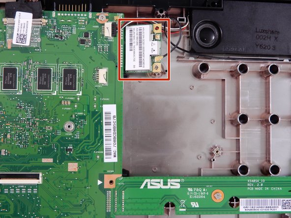 The wireless cared is located in the upper left portion of the device case, right above the fan and attached to the motherboard.