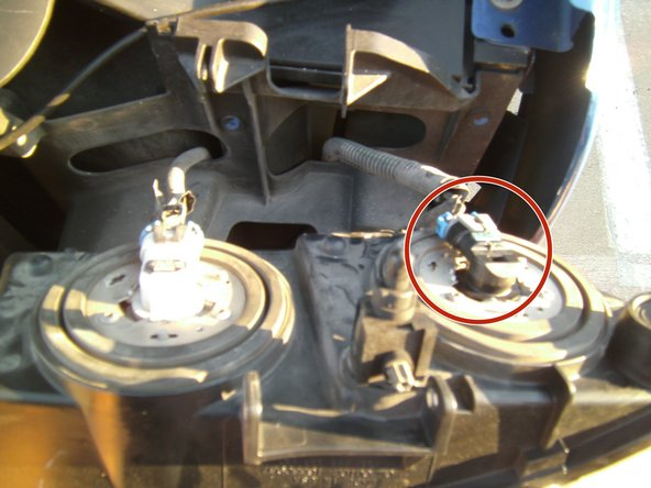 After removing the pin, you should now be able to tilt the headlight downward to gain access to all of the wires.