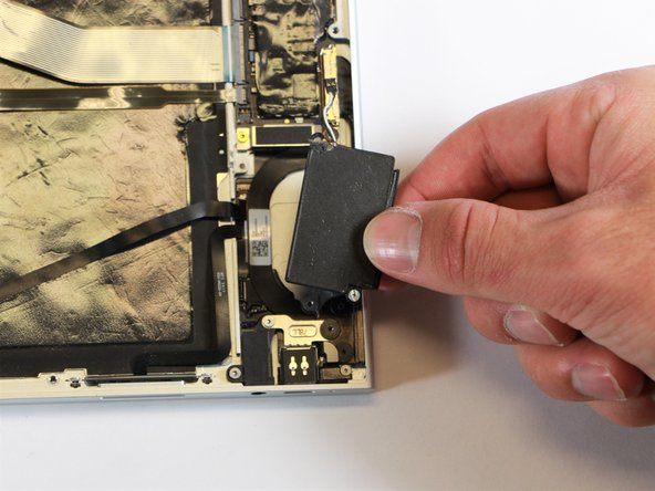 Remove the thin, black component by pulling it up and out of the laptop with your fingers.