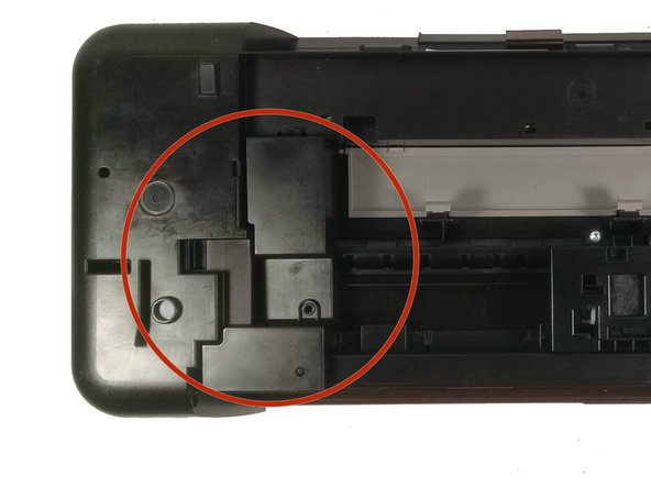 Flip the printer upside down and locate the cover on the left hand side.  It is rectangular shape and is held in place by two screws.  Unscrew these screws and take off cover.