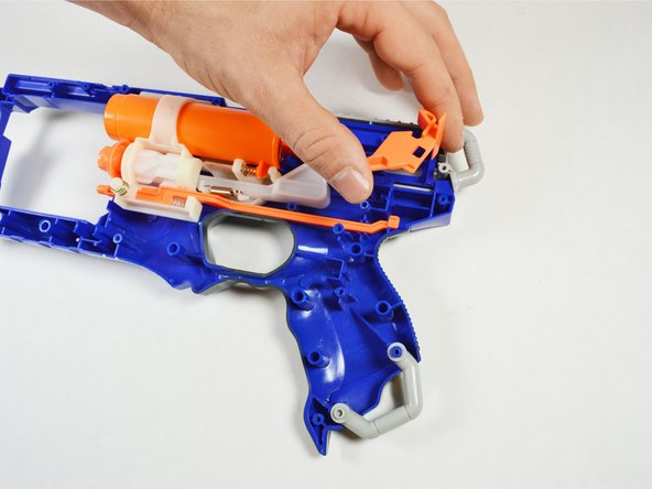 Remove the trigger, the cocking holdback, and the air compressor chamber