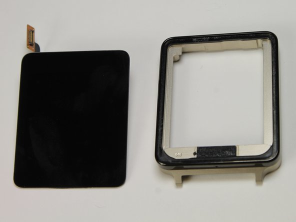 After using the pick to loosen the adhesive, simply pull the display assembly up from the metal bezel.