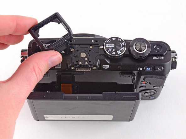Remove the external flash port casing  to expose five more screws.