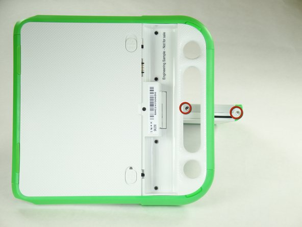 Remove the two 4mm Phillips #1 screws underneath the screen on the right-hand side.