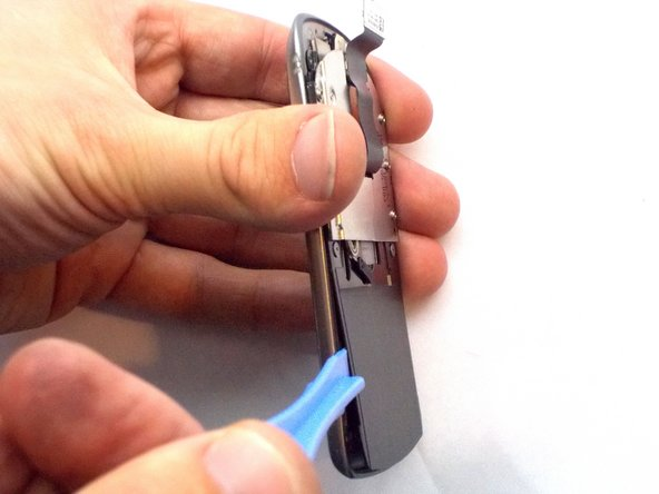 Use a plastic opening tool to separate the assembly.