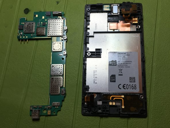 Unhook the motherboard from the central phone body